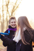Caucasian couple playing with scarf outside — Stock Photo