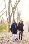 Running caucasian couple in forest — Stock Photo