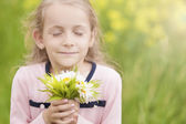Little cute girl with flowers bouquet — Stock Photo