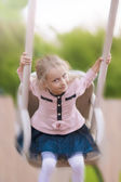 Portrait of young little girl on swing — Stock Photo