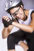 Professional female cyclist saying hello — Stock Photo