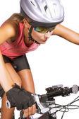 Young female cycling athlete riding mountain bike — Stock Photo