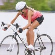 Woman cycling outdoors — Stock Photo