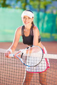 Female tennis player with racket — Stock Photo