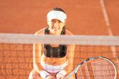 Sportswoman on clay tennis court — Stock Photo