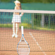Low section view of a young woman silhouette  playing tennis — Stock Photo