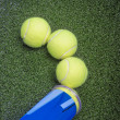 Постер, плакат: Tennis concepts: three tennis balls close to a container