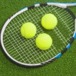 Tennis concept: racket with balls lies — Stock Photo #30512035
