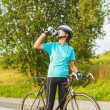 Nice Portrait of young female cyclist athlete having a break. — Stock Photo #30516635