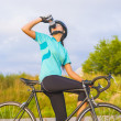 Nice Portrait of young female cyclist athlete having a break. — Stock Photo