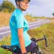 Portrait of young smiling happy female caucasian cyclist athlete — Stock Photo