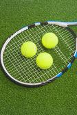Tennis concept: racket with balls lies — Stock Photo