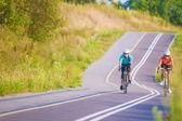Two female caucasian sportswoman riding sports bikes — Stock Photo