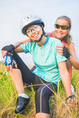 Two happy positive female sport athletes together outdoors — Stock Photo
