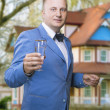 Caucasian man Holding Glass Against New House — Stock Photo