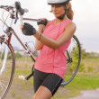 Sportswoman Works Out with Bicycle — Stock Photo