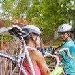 Sportswomen Work Out with Bicycles — Stock Photo