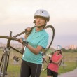 Sportswomen Work Out with Bicycle — Stock Photo