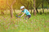 Young Female Cyclist practicing — Stock Photo