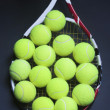 Stock Photo: Tennis Balls on Racquet Strings