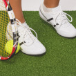 Fragment Shot of Legs of Caucasian Female Tennis Sportswoman Hol — Stock Photo