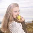 Young Female Eating Green Apple — Stock Photo
