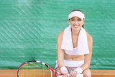 Professional Female tennis Player having rest on Bench of Tennis — Stock Photo