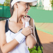 Professional Tennis Woman With Mesh tennis Bag at Court — Stock Photo #41129287