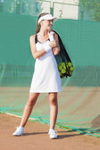 Smilling Female Tennis Woman Holding Tennis Mesh Bag with Balls — Stock Photo