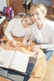 Mother with Teenage Daughter Making Origami Crafts — Stock Photo