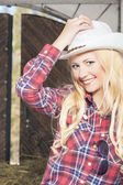 Happy Sexy Blond Cowgirl Smiling inside of the Farm House — Stock Photo