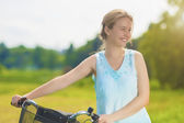 Happy Beautiful Blond Woman Having Good Time with Bicycle Outdoo — Stock Photo