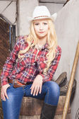 Caucasian Cowgirl In Stetson Sitting on Barrel on the Farm — Stock Photo