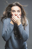 Portrait of Surprised and Silent Female Model Against Gray Backg — Stock Photo