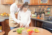 Mother and Daughter Cutting Vegetables For  Salad — Stock Photo