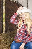 Sensual Blond Cowgirl Smiling inside of the Farm House. Vertical — Stock Photo