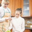 Young Caucasian Mother Teaching Her Teenage Daughter How to Cook — Stock Photo