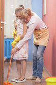 Mother with Daughter Doing Up Together Indoors — Stock Photo