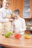 Young Caucasian Female Blond Teaching Her Daughter to Cook — Stock Photo