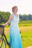 Young Caucasian Blond Laughing Outdoors Standing Near Her Bicycl — 图库照片
