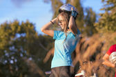 Female Cycling Athlete in Professional Cycling Gear Adjusting Hel — Stock Photo