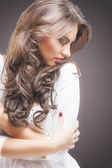 Dreaming Caucasian Brunette Woman With Crossed Hands Over Gray — Stock Photo