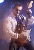 Portrait of Male Guitarist Playing with Expression. Shot with St — Stock Photo