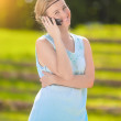 Smiling Young Blond Woman Close-up Portrait in Blue Dress Speaki — Stock Photo #48694757