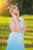 Smiling Young Blond Woman Close-up Portrait in Blue Dress Speaki — Stock Photo