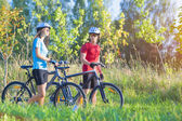 Cycling Athlets Exercising with Bicycles in Nature Environment O — Stock Photo
