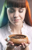 Caucasian Woman with Cup of Coffee Beans — Stock Photo
