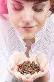 Young Caucasian Girl Holding Heap of Unbroken Coffee Beans and B — Stock Photo