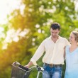 Human Relationships. Happy Couple Outdoors Walking with Bike. — Stock Photo #51045709