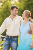 Young Couple in The Park with Bicycle — Stock Photo